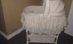 Bassinet for sale. Plays several songs and sounds, also has a night light. Top cradle is portable, base doubles as a change table and storage area. (Batteries are dieing for the music/light, will need to replace soon) See other ads.