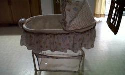 clean bassinet/cradle for sale for 50.00 OBO or trade for nice dresser...only used afew times. Also has music, vibration and light...jungle theme..only serious inquiries please. thank you :)