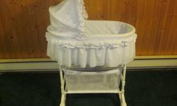 I am selling the following baby items: Bassinet / Cradle, white eyelet lace trim, bottom storage - $30 Fisher Price Vibrating / Musical Bouncy Chair - $20 Safety First Stroller with detachable infant carrier and car seat base - $40   All items are in like