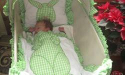 Wicker Bassinet for sale in great condition.  Folds down/white.  Comes with home made bunny blankets and pillow and bassinet cover.  Cover goes right to the floor. We can be found 30 minutes outside Guelph in Fergus area