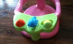 Pink bath seat. Suction cups to bath tub. Makes tub time fun, and hands free for mom. Pour water in yellow water mill, then the turtle squirts water at baby. Baby should never be left unsupervised. This ad was posted with the Kijiji Classifieds app.
