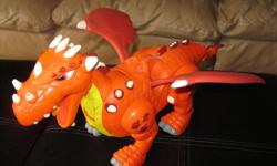 Battery-operated Dragon Primary Color - Orange Walks / roars / Opens mouth Takes 3 AA batteries (included) Son does not use anymore Can meet in west end of Ottawa (Kanata) or pickup in Constance Bay