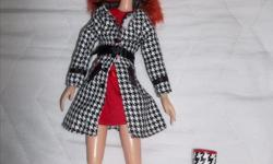 "From a pet free/smoke free home! This beautiful curly red hair doll is quite special with her articulate limb. She comes with funky socks, undies, ,red dress ,black and white coat ornate with a belt and matching rain boots. Approx 13"" Asking $10.00"