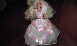 "This Barbie is gorgeous...Her dress is stunning with all the frills...Her hair very becoming...and  her sparkling gems suit the occasion!...She is in ""like new"" condition...comes from a smoke free home ...and is looking for more  excitement in her"