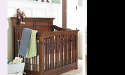 Craftsman style solid wood crib from young america. Excellent condition. No recalls or safety issues. Makes into a toddler bed and a double bed when they grow up. We would still be using it if we didn't need bunk beds!