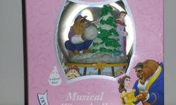 """Beauty and the Beast snowglobe. Mint condition in box. Plays """"The First Noel""""."""