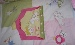 The crib bedding set includes a comforter, bumper pad, fitted sheet and the crib skirt.  The set retailed at the Spunky Monkey for $235.  My daughter did not sleep in her crib so it is like new!   The matching Valance was $40 at the Spunky Monkey.  I