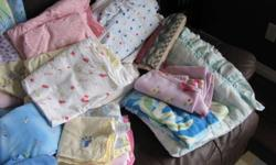 2 crib sets, Blue with animals has bumpers pads, blanket and fitted sheet $25. The pink bumble bee fitted sheet,quilt, fleece blanket and bed skirt $35 Bedding: $50.00               3 sheet sets(fitted and flat sheet)               4 blankets