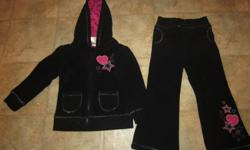 """Black and pink sweatsuit is from Zellers, size 3. The threading on it is a silver color. Asking $8.00 In excellent condition. No rips or stains. Zippers work perfectly. Will not be """"holding"""" anything unless you make a date to pick it up. Serious buyers"""