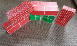 strong cardboard blocks in different sizes great for building forts, walls etc I have 2 large bags full of them, ready for outdoor or indoor play. the children have built garages,zoos, car washes, possibilities are endless.