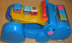 Made by Fisher Price. Ride along, then lift the seat and child can push it as he walks along. Hippo gobbles up blocks and small toys as it moves along. Storage area under the seat. Comes with 6 Peek A Blocks. No Smoking, No Pet Home In the Maples Area