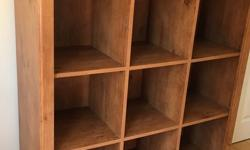 "Solid bookcase that looks like real wood but isn't. Ideal for child's room but can also be used in adult living space. Dimensions: 44""w X 15 1/4""d X 48""h. Each cubby is 12 1/2"" X 13""h. Located at DVP & Lawrence"