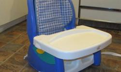 Portable booster chair by The First Years Great space-saving alternative to a highchair. Adjustable harness system. Tray is removeable. Comes from a smoke free, pet free home.