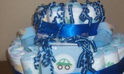 "Boy diaper cake, has over 40 diapers, 20 birth announcements, socks and ""its a boy"" mints (great treat for mom and dad). AWESOME DEAL $20"