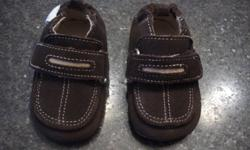 Chocolate brown boys Robeez shoes. Never worn, size 3-6 months. $15 obo Please reply to ad with name and phone number.