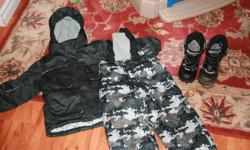 I am selling my son's snowsuit which is 3T and is grey and black.  It is the brandname Sportek and is gently used.  The boots are Airwalk boots size 10 and are in excellent condition.  The hat pictured here is also included.  From a smoke free/pet free