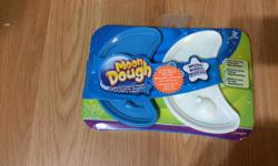 Never been removed from package. Sort of like play-doh but never dries out! Comes with blue and white. Please let me know if you have any questions.