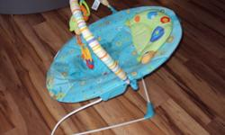 For Sale: Bright Starts Vibrating Bouncy Chair with toy attachment.