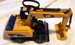 BRUDER Cat- Wheeled Excavator. Perfect condition. This was a gift which unfortunately did not get used. Paid $100 at a specialty toy store. The price is firm. Thank you.