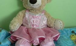 Build-A-Bear Teddy Bear with red stitched on heart. Includes Ballerina dress and ballet slippers and silk pink underwear. Plus matching bows. Great condition. Practically new.