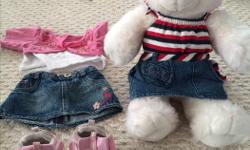 Build a bear including two outfits. Steal of a deal !!!! I may even have more outfits but two for sure.