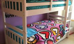 White bunk bed in excellent condition. Has storage underneath bottom bunk. Bought from Sears in 2013. Includes 1 mattress. Can also be used as 2 single beds.