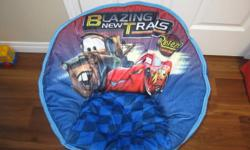 "Blue ""Cars"" theme saucer chair for sale. In nearly new condition, have only had a few months. I am selling because my son got a new armchair style chair for Christmas."