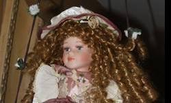 Ceramic doll on swing $5
