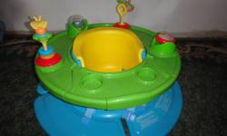 Chair with buckles, to secure infant, feeding tray and toys.