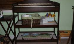 Top quality solid Dark wood Change table.  With Change pad and belt.  Perfect for changing your baby and a beautiful addition to any nursery. Excellent Condition.  Smoke free home.