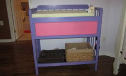 change table painted purple and pink. one drawer with lots of room for diapers and wipes and a lower shelf for additional storage. Change pad and cover included.