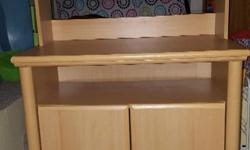 Change table in excellent used condition. Hutch that can easily be removed and cupboards with shelves.