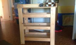 This handmade shelf can be used as a change table or a storage shelf. Perfect for people who are tall and find changing a baby on a standard change table hard on the back.