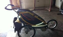 Chariot stroller with bike attachment. Rides great. A little wear and tear. But great condition. Retails for over $700 in stores. Asking 425 obo. Make me an offer. This ad was posted with the Kijiji Classifieds app.