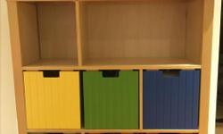 "Solid bookcase with 6 removable multi-coloured cubby boxes ideal for a child's room. Dimensions: 40""w X 43 1/4""h X 14""d Each cubby is 10.5""w Located at DVP & Lawrence"