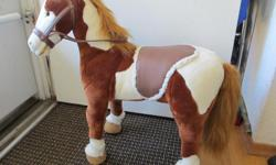 This toy horse is apprx 2 feet long x 2feet tall. It has a soft exterior, and a supportive wooden interior, so kids can sit on it. It's in great shape.