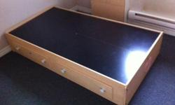 For single mattress. Wooden bed frame with two built in drawers Dimensions (L X W X H): 77 3/4 x 41 1/2 x 14 1/4 Must pick up.