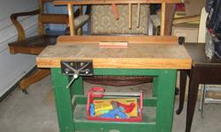 This is a real miniature child's workbench with working vice, slot for tools - includes some child sized real tools. Just like daddy's!!