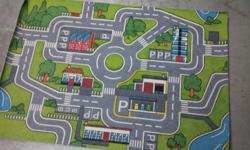 "Measures 52.5"" x 36"". Very clean, as it was 'gently' (rarely) used. The layout provides streets, roundabout, gas station & parking stalls etc...great for hot wheels! Please call. Seller will NOT respond to texts or emails."