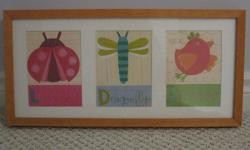 This cute and colourful picture looks great in a child's room. There are three panes which feature a picture of a ladybug, dragonfly and sparrow. View the images for a close-up of each (please excuse the glare from the camera). Wood frame Super condition