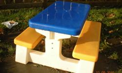 This is a great outdoor picnic table for the little ones! Seats 4 children comfortably On table top there is a hole in the centre that allows you to place an umbrella for shading. Ages 2-5 years Great condition *For more info call 765-3989.