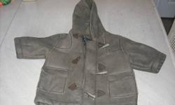 Childrens Place brown coat Size 6-9 months! Made big in size! Coat isn't discolored, Camera wasn't taking good pics! Sorry! Non-smoking home! Located in Eastern Passage