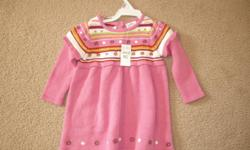 Never worn knit dress. Size 6-9 mths. Still with tags on.   See my other ads for more girl's clothing.