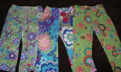 Size 2T clothing. All in LIKE-NEW CONDITION! 3 pairs of pants (patterned - various) 1 pair of cords (green) 1 pair of fleece pants (green) ( 1 skirt (with shorts underneath) - blue floral 1 shirts (one short sleeve on long sleeve) 1 fleece zip-up sweater