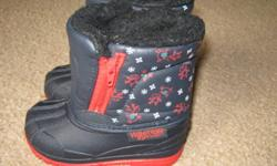 Unisex black and red winter boots with reindeer on them. Zippers up the side to get them on easier. Like new condition. Smoke and pet free home. Please see my other ads....