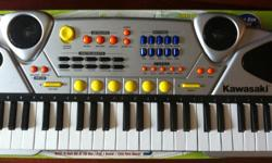 Kawasaki musical keyboard. Songbook included. Great sounding for an affordable price! Gently used!