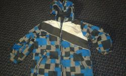 Boys winter coat in size 5/6, in blue, white and grey tones, and made by Children's Place. Item is in good condition and comes from a non-smoking, pet free home.