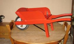 One of a kind wooden wheelbarrow. Could be a child's toy or garden decor.
