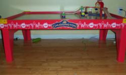 This Chuggington Train Table is literally only days old. We bought it for our son for Christmas and ended up winning the exact same one two days after Christmas!! go figure...So this is a BRAND NEW, solid wood and fully assembled table. It's pretty big