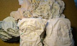 Cloth diapers for sale, gently used. -21 infant size -21 larger (adjustable) sizes -12 covers -10 rubber pants Various brands.